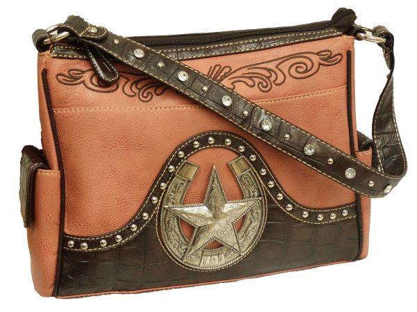 Rose colored leather purse with large engraved horse shoe and star.