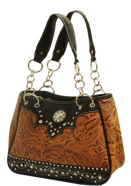 Medium color leather purse with embossed floral print accented with black leather trim with crystal rhinestones