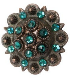 Antique copper colored rosette concho with teal rhinestones.