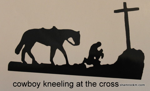 cowboy kneeling at the cross
